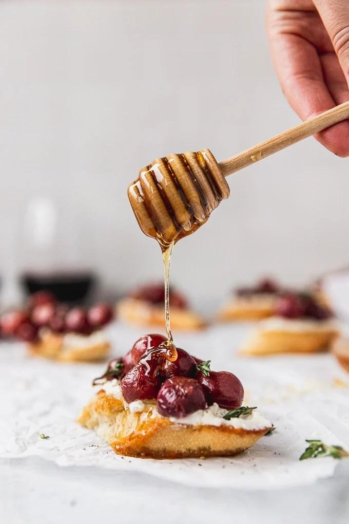 honey drizzle on grape crostini