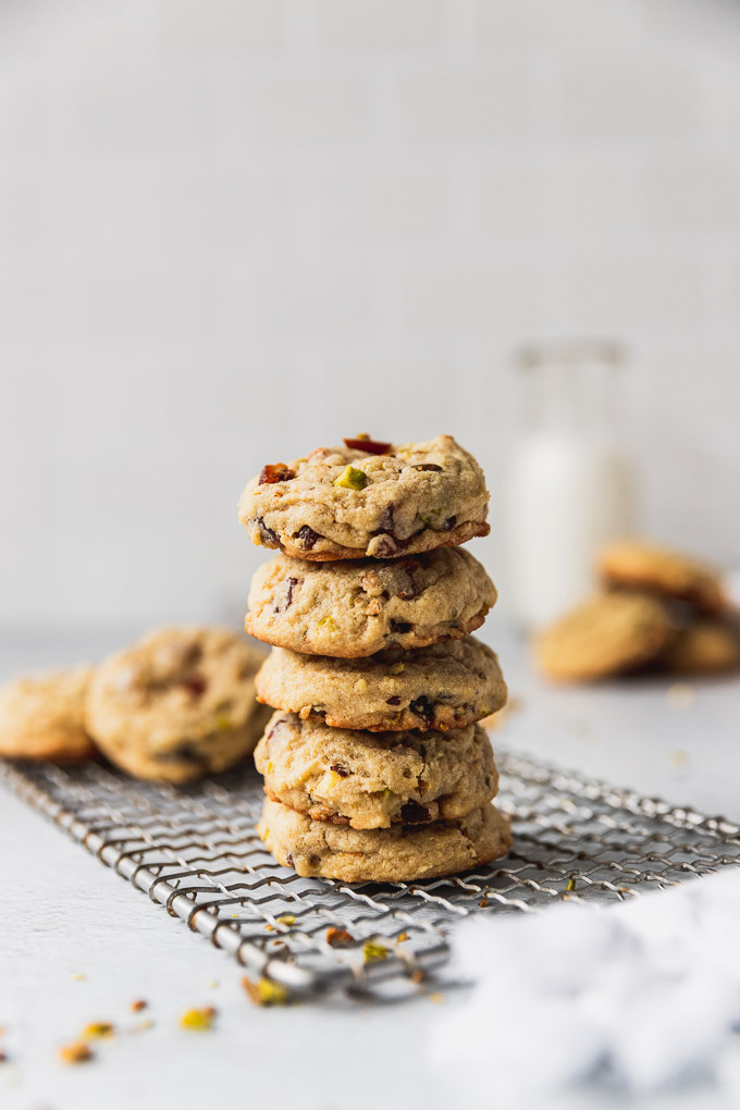 stack of apricot pistachio cookies on wire rack