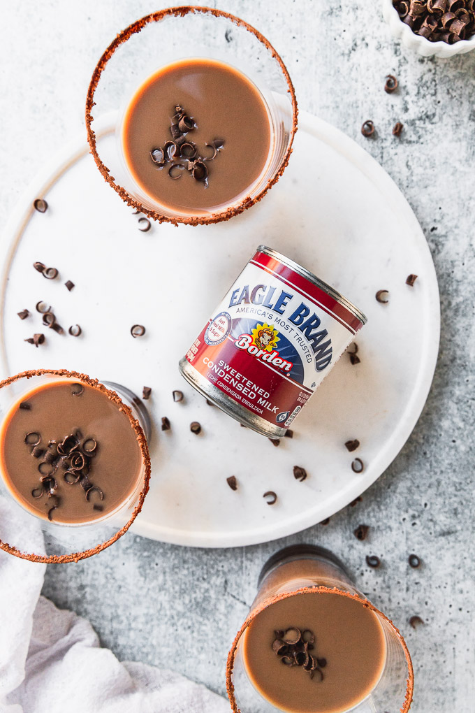 can of eagle brand sweetened condensed milk next to chocolate white russians overhead