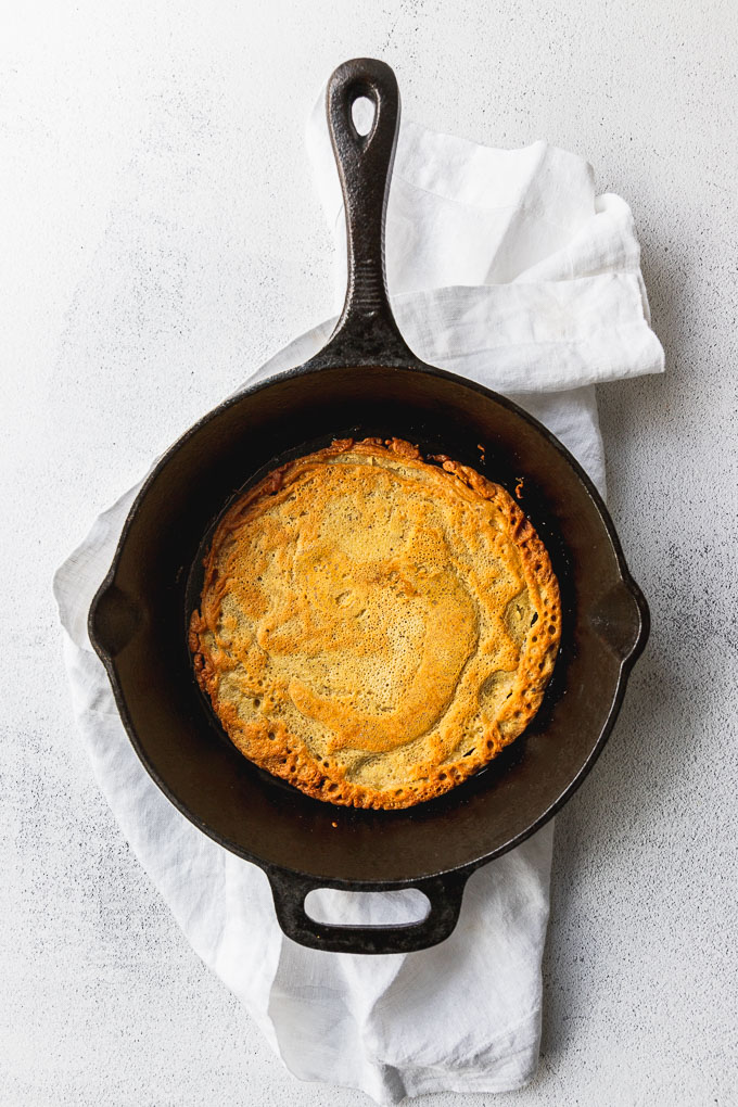 socca chickpea flatbread in cast-iron skillet