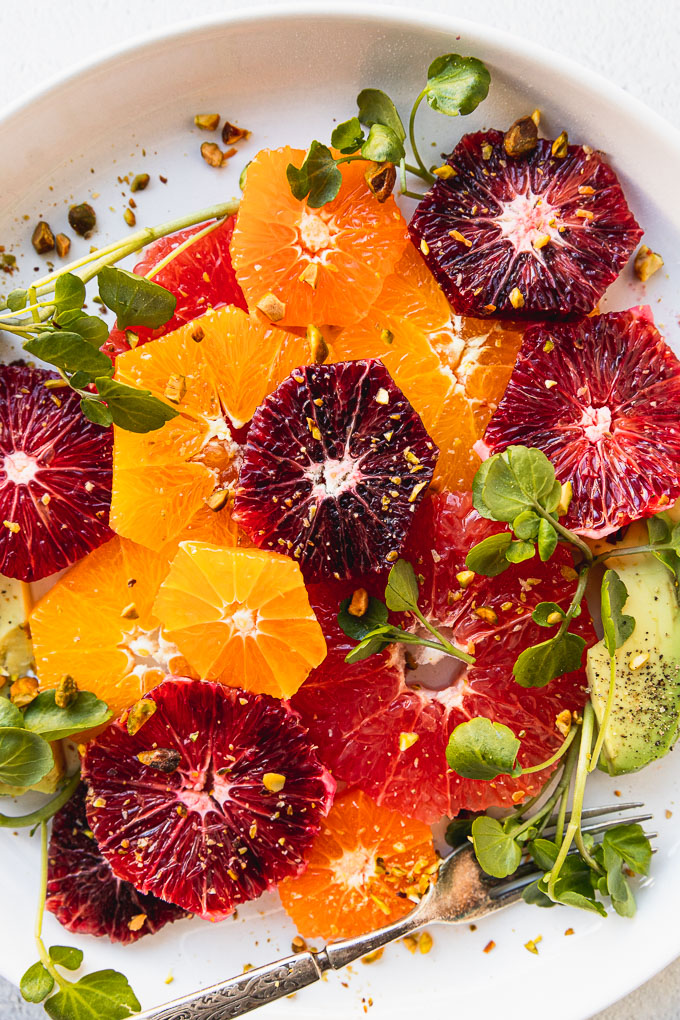 up close citrus salad with avocado and watercress