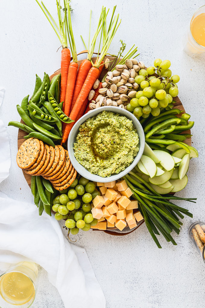 overhead view of st. patrick's day snack board with edamame hummus
