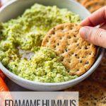 cracker dipping in edamame hummus