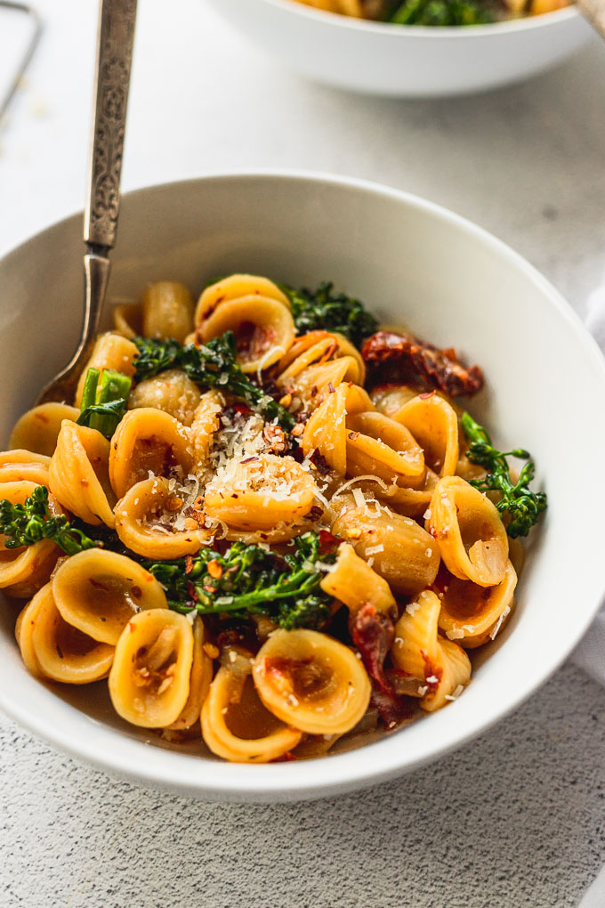 up close bowl of orecchiette pasta with spoon