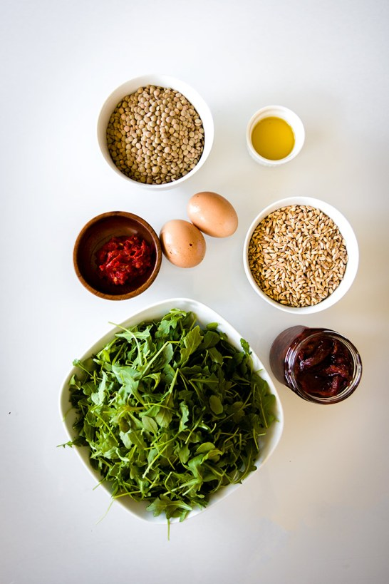 Easy Lentil Bowl with Sunny Egg & Harissa, a simple lentil bowl with farro, onion, arugula and sun dried tomatoes topped with a sunny egg and spicy harissa