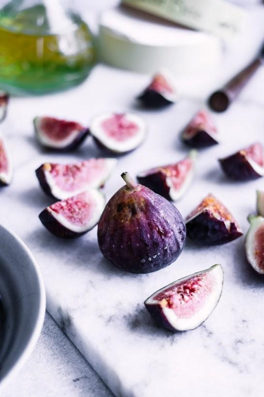 Sliced figs on a cutting board.