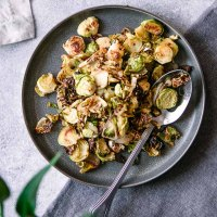 crispy roasted brussels sprouts with maple syrup and mustard on a blue plate