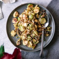 A simple brussels sprouts side dish on a white table for Thanksgiving