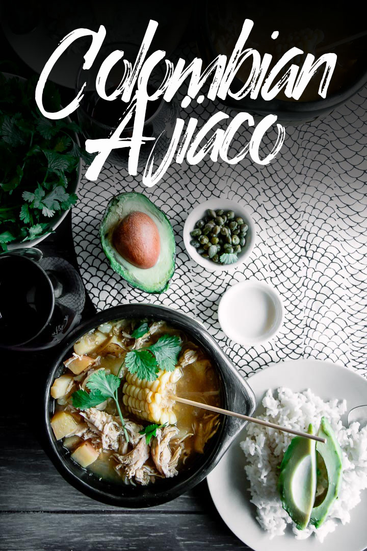 Wow, this soup is delicious! Colombian Ajiaco, a traditional chicken and potato soup from Bogota. Made with three types of potatoes, corn, cilantro, green, onion, capers, cream, avocado, and the South American guascas herb, this Colombian soup will make you feel like you're eating in Bogota! #colombia #colombianfood #soup #stew #bogotano