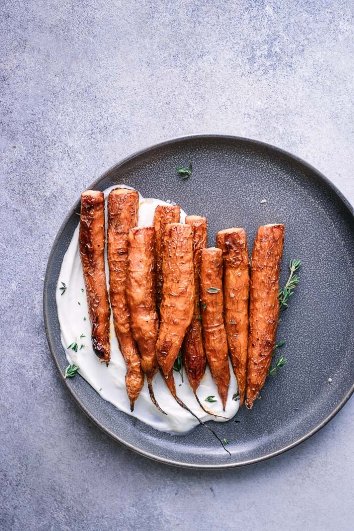 Carrots on a blue plate on a blue table.