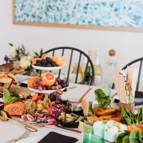 """A table with food and the words """"what is green eating"""" in black writing."""