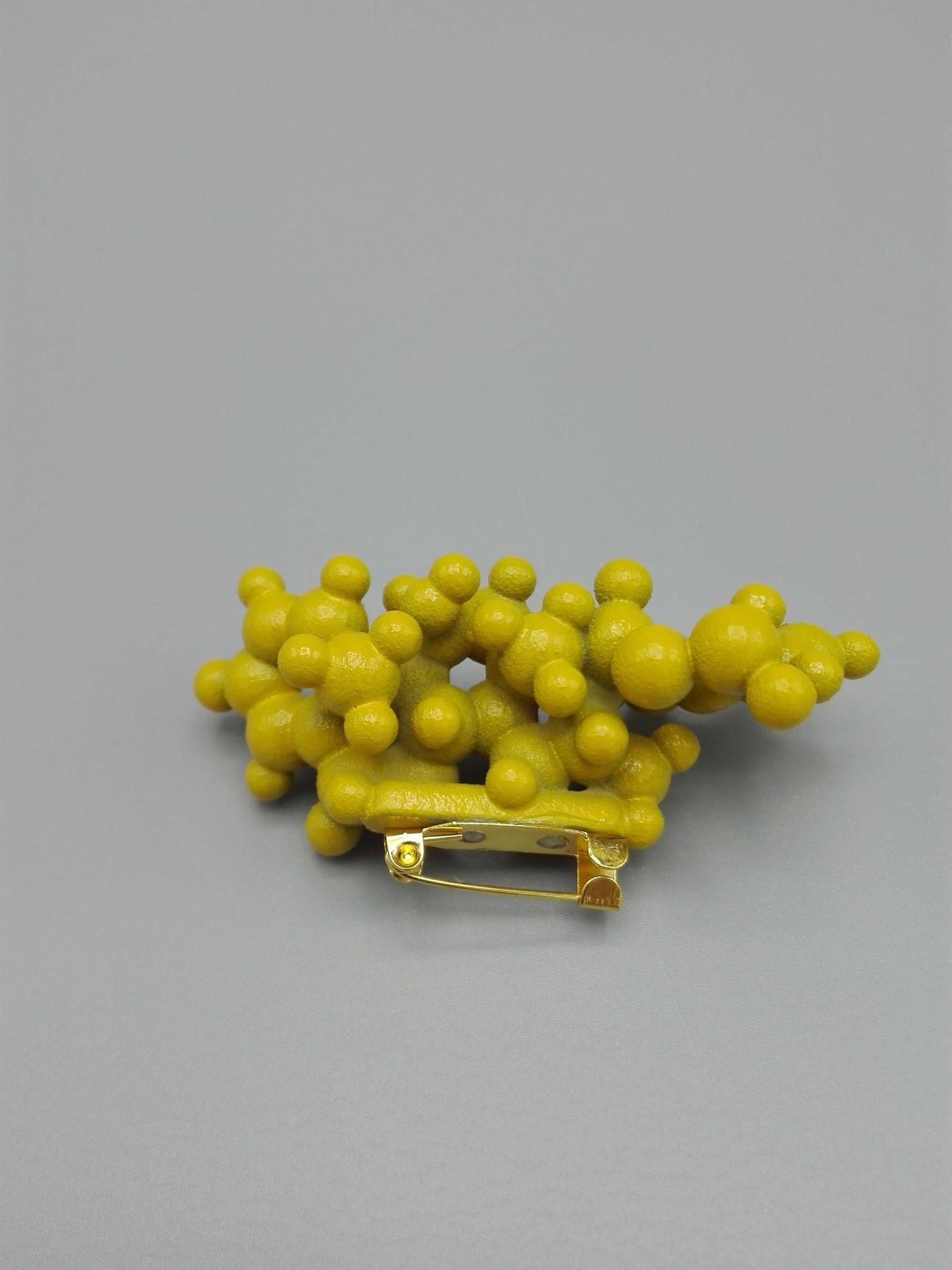 3d printed brooch of molecule