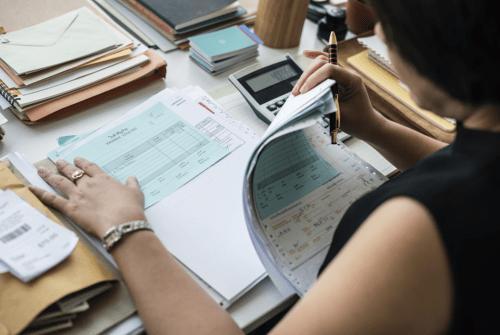 Accountant sorting bills