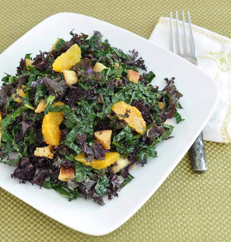 kale salad with tangerines, tiny garlic croutons,  and spicy tahini dressing