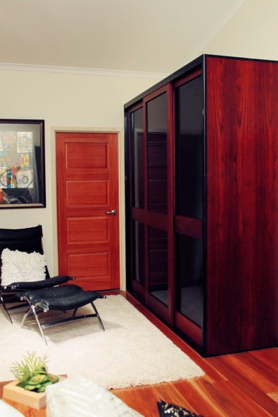Built in timber sliding doors with black glass