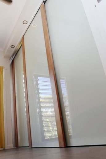 Tasmanian Oak Timber Closet Doors with white glass panels