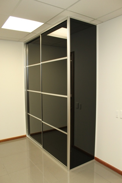 Executive office installation.Multi Panel doors. Black glass with black glass gable end.
