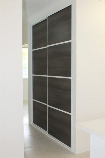 Hallway Cupboard Sliding Doors situated near the kitchen