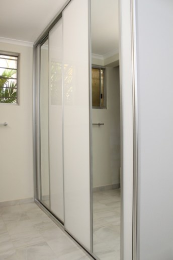 Bathroom Cupboard Sliding Mode Doors White Glass and two vertical strip mirror