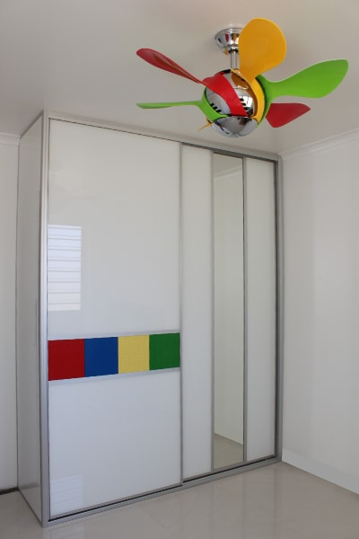Kid's room Sliding Doors featuring lego panels and matching fan