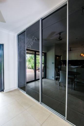 Large Sliding Kitchen Doors black glass featuring Bloodwood blossom picture