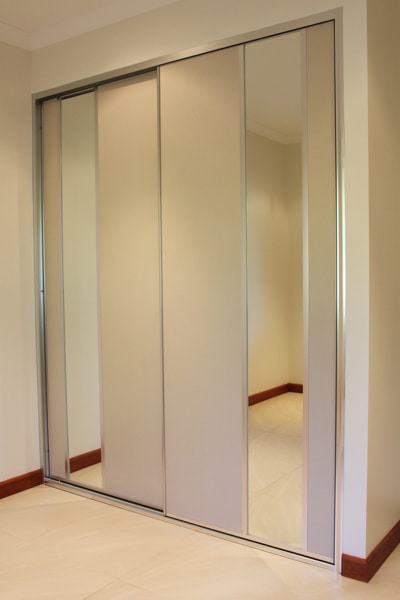 Sliding Bedroom Doors with beige panel and mirror insert panels