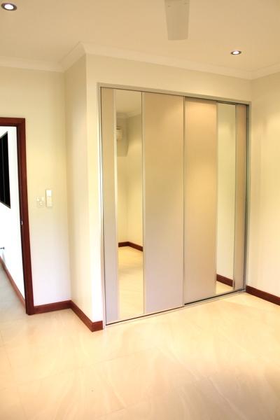 Tropical Scandi Bedroom with Rock Salt Sliding Doors featuring dress mirror