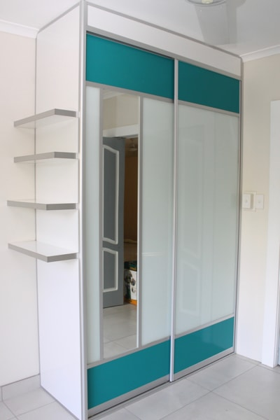 Closet Wardrobe Sliders with Aqua mesh panels and vertical mirror