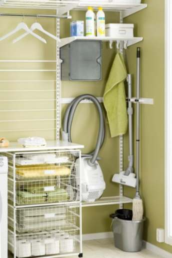 elfa laundry storage combining utility and classical shelving items