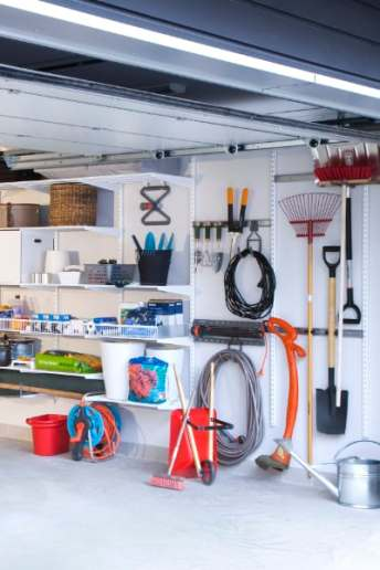 elfa garage wall storage wire shelving and baskets