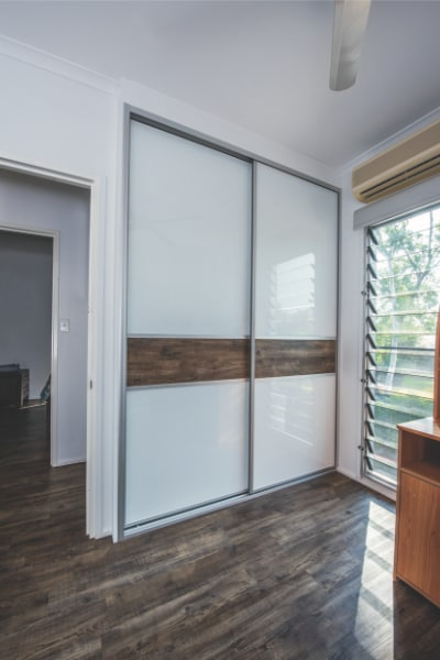 Bedroom Sliding Wardrobe Doors featuring Floating Timber Floorboards