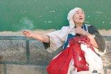 Maria cu chei la brau