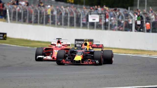 Sebastian Vettel (GER) Ferrari SF70-H and Max Verstappen (NED) Red Bull Racing RB13 battle for position at Formula One World Championship, Rd10, British Grand Prix, Race, Silverstone, England, Sunday 16 July 2017. © Sutton Images