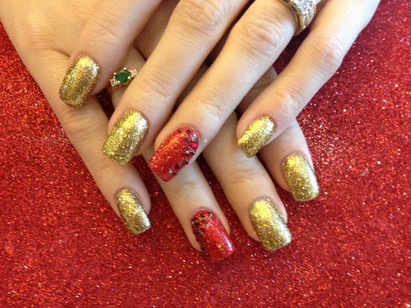 Brillantini rosso e oro impreziositi con decorazione di strass rossi
