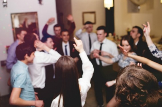 Group Of Young People Having Fun Dancing At Party