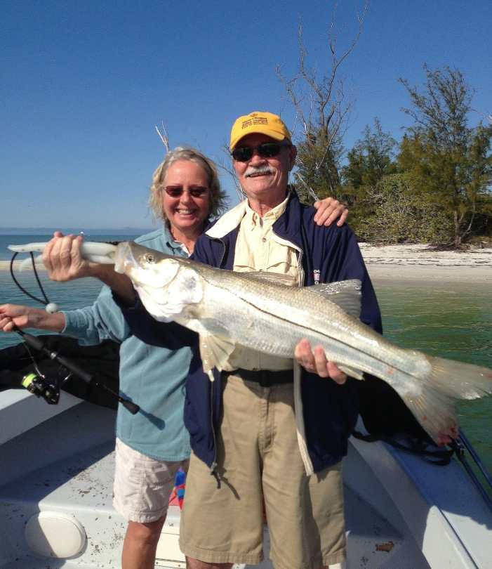 Big Snook, Happy Couple, Redfish Pass, Fort Myers, Sanibel & Captiva Charters & Fishing Guide Service.