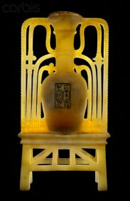 """12 Dec 2006 --- Elongated vase flanked with open work floral ornament cemented to a trellis stand. On the bowl of the vase is a rectangle incised and filled in with black pigment. The flank ornament of the vase comprises lotus and papyrus floral design symbolizing the binding of the """"Two Lands."""" 