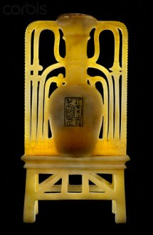 "12 Dec 2006 --- Elongated vase flanked with open work floral ornament cemented to a trellis stand. On the bowl of the vase is a rectangle incised and filled in with black pigment. The flank ornament of the vase comprises lotus and papyrus floral design symbolizing the binding of the ""Two Lands."" 