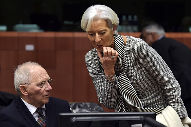 Germany's Finance Minister Wolfang Schaeuble (L) chats with Managing Director of the International Monetary Fund (IMF) Christine Lagarde during an extraordinary euro zone finance ministers meeting (Eurogroup) to discuss Athens' plans to reverse austerity measures agreed as part of its bailout, in Brussels February 20, 2015. Greece has made every effort to reach a mutually beneficial agreement with its euro zone partners but will not be pushed to implement its old bailout programme, its government spokesman said on Friday. REUTERS/Eric Vidal (BELGIUM - Tags: POLITICS BUSINESS) - RTR4QG4G