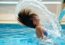 girl swinging hair on pool