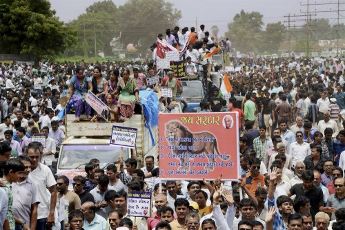 Vadodara: People from Patidar or Patel community hold placards and shout slogans during a protest rally demanding reservation for their community in Vadodra on Friday. PTI Photo (PTI8_21_2015_000096B)