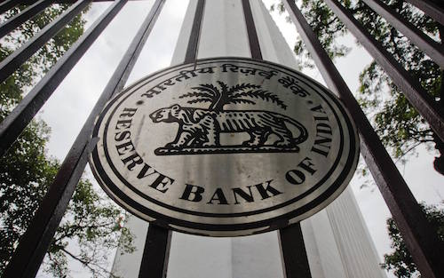 The Reserve Bank of India (RBI) logo is pictured outside its head office in Mumbai in this July 26, 2011, file photo. India's central bank left interest rates unchanged on March 15, 2012 and warned of resurgent inflation risks, a hawkish stance that disappointed investors clamoring for the first rate cut since the aftermath of the global financial crisis. REUTERS/Danish Siddiqui (INDIA - Tags: BUSINESS LOGO)