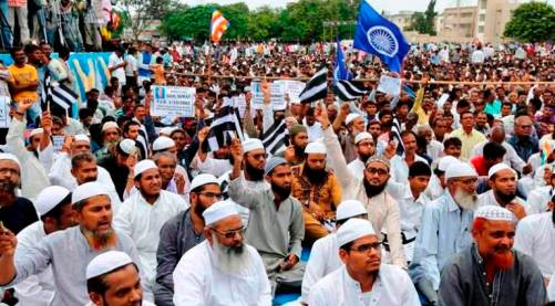 Muslims and hundreds of members of India's low-caste Dalit community gather for a rally in Una, India, Monday, Aug. 15, 2016. Four Dalits were brutally beaten by alleged vigilantes for skinning a dead cow at Mota Samadhiyala village near Una town in western Gujarat state. Dalits began a march on Aug. 5 from Ahmedabad to Una to protest against the atrocities on their community in the state. (AP Photo/Ajit Solanki)
