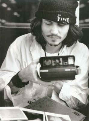 johnny-depp-with-a-polaroid