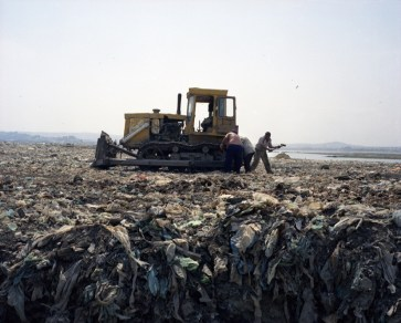 Workers on a landfill. Baku, Azerbaijan. 2010
