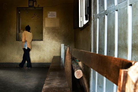 Entrance of the juvenile detention center. A young mother waits for authorization to deliver food to her son.