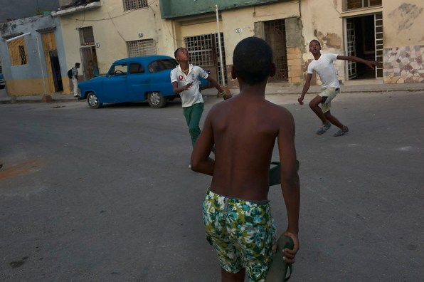 Boys playing soccer/football on the street after school. In every street in Havana one can find kids playing ball. Habana Vieja, barrio San Judas Tadeo. November, 2013.