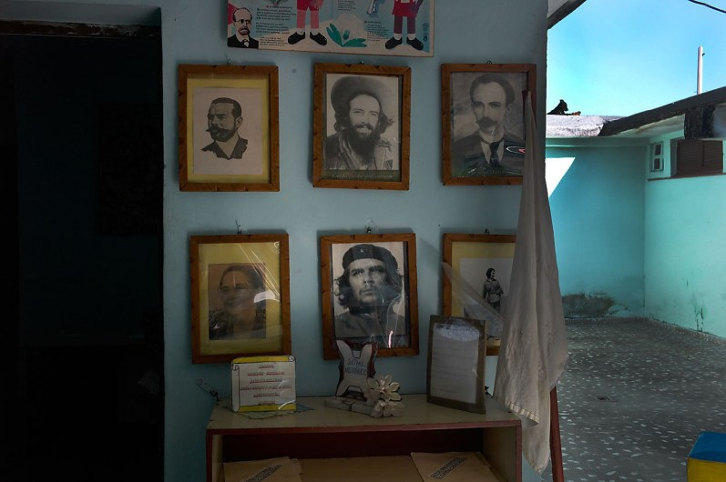 """Entrance hall in a day care center in Habana Vieja. National heroes are on display, amongst them """"el Che Guebara"""" and Camilo Cienfuegos. El """"Che"""" is loved by all. November, 2013."""