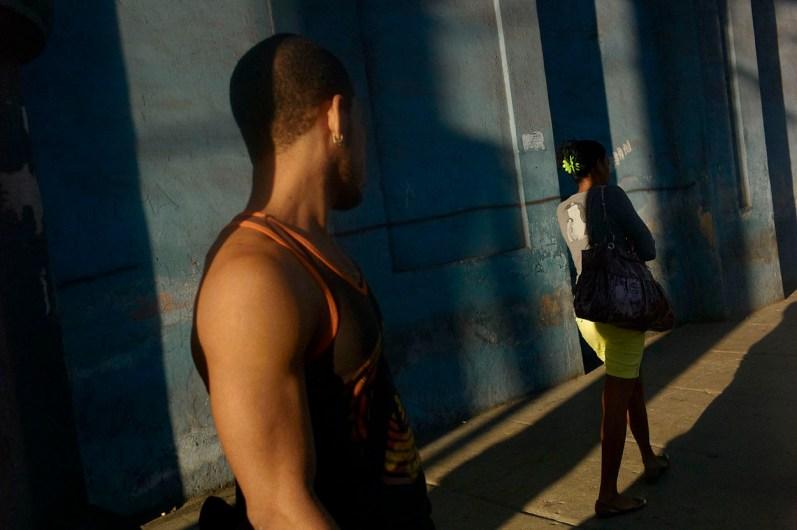 Man looking at a passing girl. Habana Vieja, November, 2013.