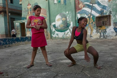 Girls playing and dancing in the street after school. Usually the kids go play in the streets after school until diner time. San Judas Tadeo, Habana Vieja, November, 2013